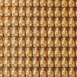 Hundreds of golden Budhha statues background — Stock fotografie