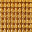 Hundreds of golden Budhha statues background — Stock Photo