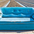 Very old vintage blue sofa on the street — Stock Photo #8969493