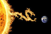 Fire dragon from the Sun heading towards Earth — Stock Photo
