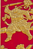 čínská zlatá zdi umělecké dílo na červené dřevo — Stock fotografie