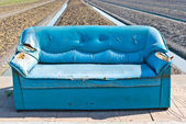 Very old vintage blue sofa on the street — Stock Photo
