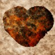 Stock Photo: Rusty heart logo background