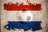 Bandera de holanda rip con fondo de fútbol — Foto de Stock