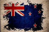 New Zealand flag on old vintage paper background concept — Stock Photo
