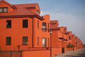 Beautiful orange apartments with blue sky — Stock Photo