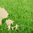 Stock Photo: Paper cut of family with house and tree on fresh spring green gr
