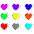 Colorful heart shape hole through  paper — Stock Photo