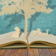 Paper cut of children read a book under tree on old book — Stock Photo #10462956