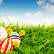 Stock Photo: Easter Eggs with flower on Fresh Green Grass