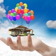 Stock Photo: House lifted by Balloons