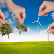 Hand hold wind turbine and tree over blue sky — Stock Photo