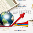Stock Photo: Pen and business graph with earth