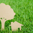 Stock Photo: Paper cut of house and tree on fresh spring green grass