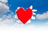 Herz form loch durch papier — Stockfoto