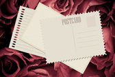 Red rose and old card — Stock Photo