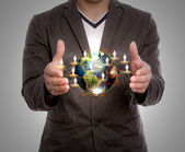 Business man hold earth — Stockfoto
