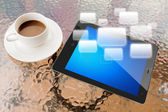 Digital tablet and cup of coffee on work table — Photo