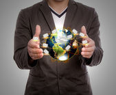 Business man hold earth of mail — Stock Photo