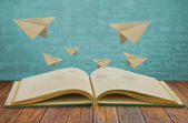 Magic book with paper plane — Stock Photo
