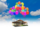 A house lifted by Balloons — Stock Photo