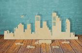 Papier gesneden van steden met een auto en vliegtuig — Stockfoto