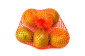 Mesh oranges Isolated on white background — Stock Photo
