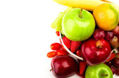 Fresh fruit on plate Isolated on white — Stock Photo