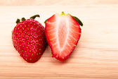 Strawberry on wooden table — Stock Photo