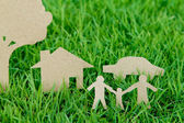 Paper cut of family with house , tree and car on fresh spring gr — Foto Stock