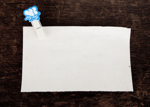 Old paper and clothes peg — Stock Photo #10460930