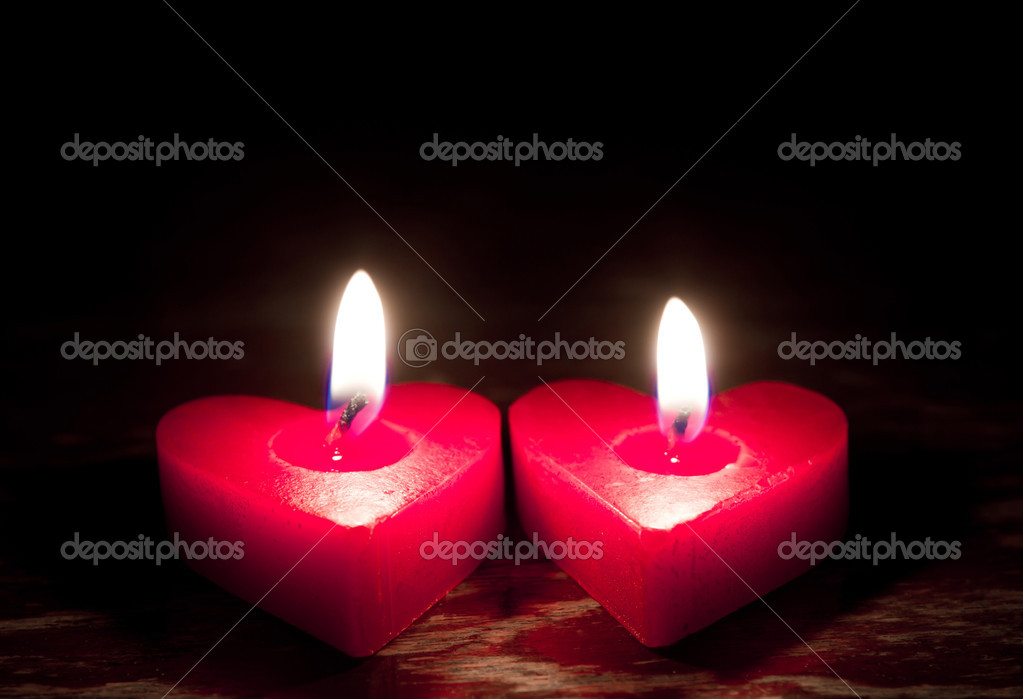 Red burning heart shaped candles — Stock Photo #10460810