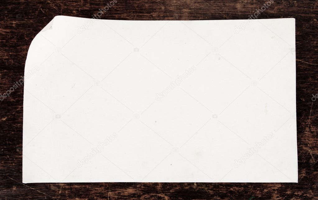 Old paper on the wood background — Stock Photo #10460888