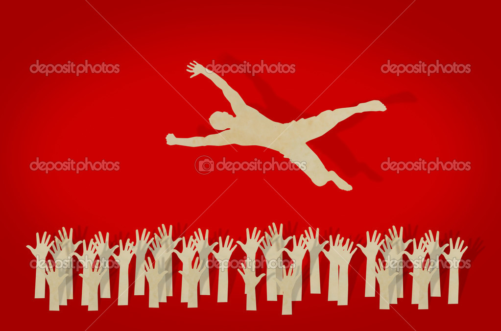Jubilant Crowd Paper Cut of Man Jump Over Jubilant Crowd Photo by Jannystockphoto