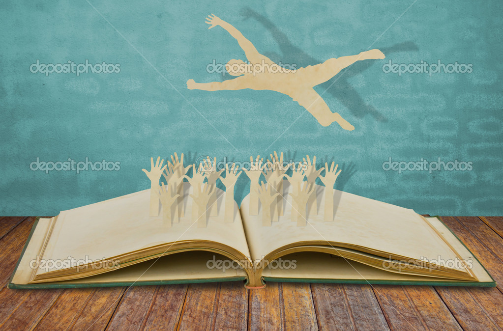 Jubilant Crowd Paper Cut of Man Jump Over Jubilant Crowd on Book Photo by Jannystockphoto