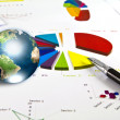 Pen and business graph with earth (Elements of this image furnis - Stock Photo