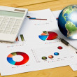 Stock Photo: Pen and business graph with earth (Elements of this image furnis