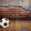 Soccer ball in the old brick room — Stock Photo
