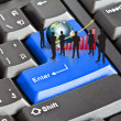 Stock Photo: Silhouettes of busineswith red graph and earth on enter keyboard