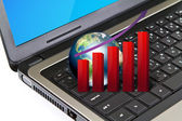 Laptop with graph and earth (Elements of this image furnished b — Stock Photo