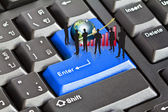 Silhouettes of busineswith red graph and earth on enter keyboard — Stockfoto