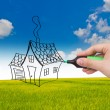 Stock Photo: Business hand with pen drawing a house