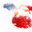 Blue ,red and gold christmas balls with snow — Stock Photo