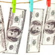 Stock Photo: Dollars on a rope isolated on white