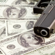 Close up image of pistol and dollar — Stock fotografie