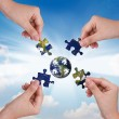 Business concept with a hand building puzzle globe — Foto Stock