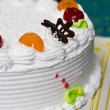 White Cream Cake with Fruits and Chocolate - Stock Photo