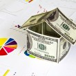 House made from dollars on financial Graphs — Stock Photo #10614434