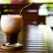Ice cold coffee on a wooden table — Stock Photo #10615447