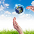 Eco concept : Hand hold globe in bubbles against the sun and the — Stock Photo